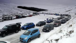 Cars parked on the A470 near Storey Arms