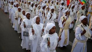 One church choir for di Meskel Suqare, Addis Ababa Ethiopia dey perform for di Meskel Festival to remember di discovery of di true cross wey dem use crucify Jesus Christ.