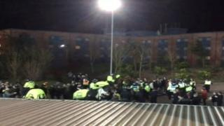 Police and fans at Oxford United and Millwall FC match