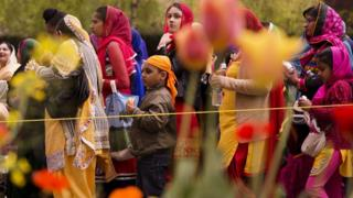 Families watching a Vaisakhi procession