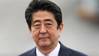 Japanese Prime Minister Shinzo Abe arrives at Joint Base Pearl Harbor Hickam, Monday, Dec. 26, 2016, in Honolulu.
