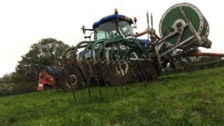 A tractor spreading slurry in County Antrim