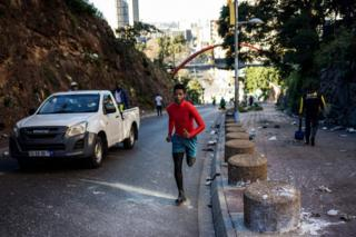 People train in the streets of Hillbrow, Johannesburg on May 1, 2020