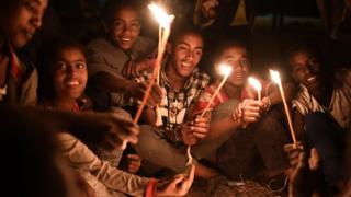 People holding candles during the annual Timkat epiphany celebration in Gondar, Ethiopia - Wednesday 18 January 2017