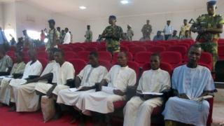 "members of Nigeria-based Islamist group Boko Haram sitting in court in N""Djamena, during the opening of the trial of ten suspected Boko Haram members"
