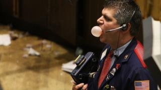 trader blowing bubble gum