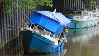 Boating hanging from moorings on River Avon