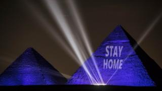in_pictures The pyramids are illuminated in blue with the message