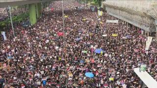 Thousands of protesters march through the city