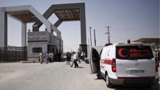 A Palestinian ambulance waits to cross into Egypt at the Rafah border crossing in the southern Gaza Strip, on 20 August, 2015