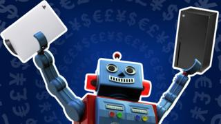 A photo illustration shows a toy robot waving a PlayStation 55 and Xbox Series X in the air, against a blue background littered with currency symbols radiating outwards in concentric symbols