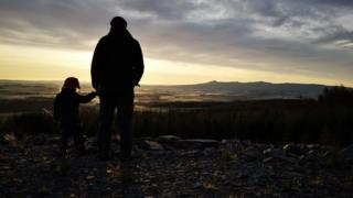Man and child in silhouette