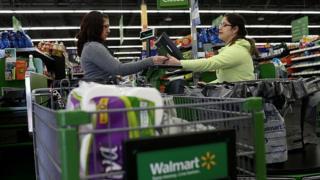 Walmart employee takes payment