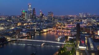Four lit London bridges