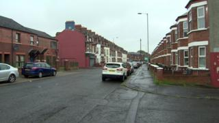 The man was stabbed in the face close to the junction of Harcourt Drive and Manor Street in north Belfast