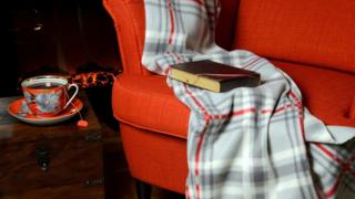 Sofa, blanket, open fire, tea and book