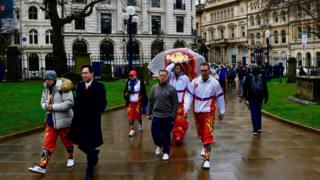 The Chinese lion team arrive at St Philip's