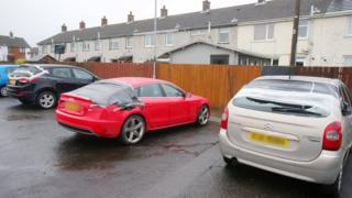 The damaged cars were parked at Carnrawsy Walk