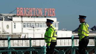 Police on patrol by Brighton pier
