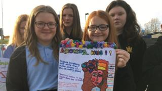 Year 8 pupils from Cyfarthfa High School in Merthyr Tydfil have designed posters to try and stop people smoking outside their hospitals