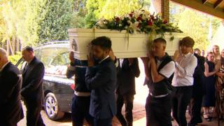 Reece Hornibrook's coffin being carried