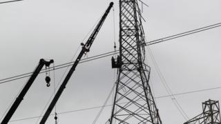 Workers repair the power grid