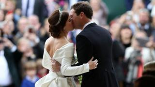 Princess Eugenie and Jack Brooksbank kiss in front of St. George's Chapel