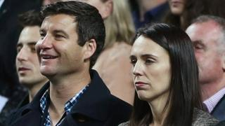 New Zealand Labour Party leader Jacinda Ardern (2nd R) and her partner Clarke Gayford (2nd L) stand at an international netball match in Auckland, New Zealand, October 5, 2017.