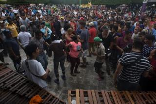 Migrants dance was local musicians play music in the central square of Ciudad de Hidalgo