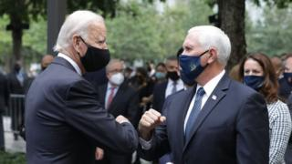 Democratic presidential nominee Joe Biden (L) and Vice President Mike Pence (R) greet each other during a 9/11 memorial service at the National September 11 Memorial and Museum on September 11, 2020 in New York City. The ceremony to remember those who were killed in the terror attacks 19 years ago will be altered this year in order to adhere to safety precautions around COVID-19 transmission