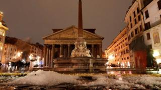 Hail covers the Piazza della Rotonda in front of the Pantheon in central Rome