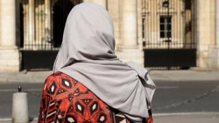 A woman wearing a Muslim headscarf stands outside France's top administrative court in Paris (Aug. 26, 2016)