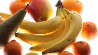 Bananas surrounded by other fruit
