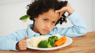 A child eating vegetables