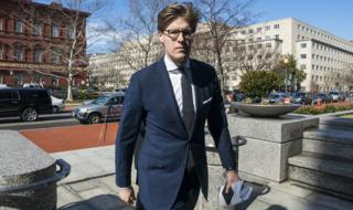 Alex Van Der Zwaan walks into the Washington field office of the FBI