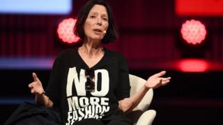 Fashion designer Katharine Hamnett wearing a t-shirt that says 'No more fashion victims'
