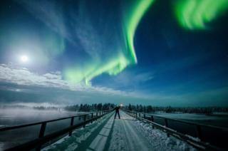 The Aurora Borealis (Northern Lights) seen over the sky near Inari in Lapland, Finland. 14 February 2019.