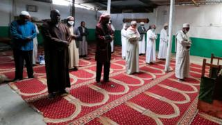Muslim faithful observe social distancing as they perform Eid al-Fitr prayers, marking the end of the holy fasting month of Ramadan, inside a mosque closed amid concerns about the spread of the coronavirus disease (COVID-19), in Nairobi, Kenya, May 24, 2020.
