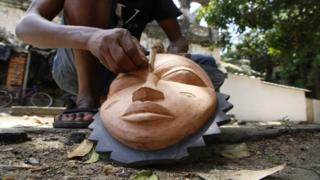 in_pictures A sculptor carves a mask in his sculpture workshop in Grand-Bassam, Ivory Coast