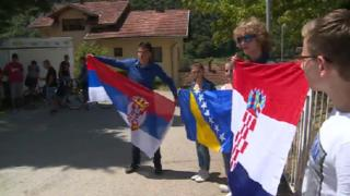 Students holding the Serbian, Bosnian and Croatian national flags during a protest in July