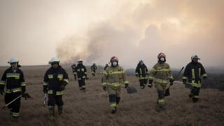 environment Firefighter attacks flames in Poland