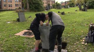 Headstone being put up