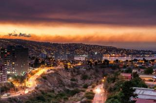 Smoke billows from the forest around Valparaiso, in Chile