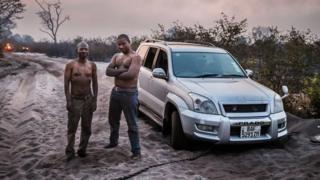 Zambian aid worker Robert Ntitima (right) and driver Clinton Bakala
