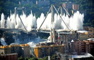 Controlled explosions demolish what remains of the Morandi bridge