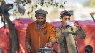 Men cook tea at a roadside stall in Pakistan