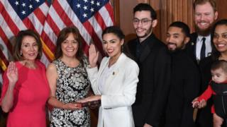 Ms Ocasio-Cortez (in white) was sworn in on Thursday as the youngest ever US congresswoman