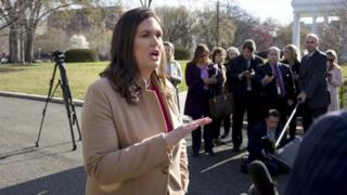 White House Press Secretary Sarah Huckabee Sanders speaks to members of the news media following a television interview during which she spoke on Special Counsel Robert Mueller's report on Russian interference in the 2016 election, outside the West Wing of the White House in Washington