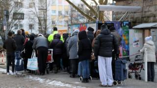 People wait outside the food distribution centre at the Tafel in Essen, Germany, 26 February 2018