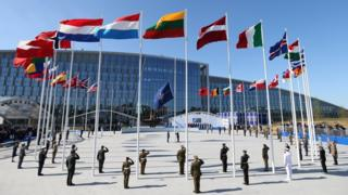 Flags of Nato member countries fly during a ceremony at the new headquarters in Brussels, 25 May